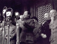 declares the founding of the PRC in 1949