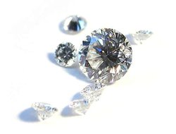 A scattering of round-brilliant cut diamonds shows off the many reflecting facets.