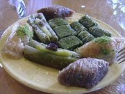 A plate with pieces of different types of Baklava