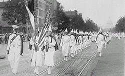 Ku Klux Klan members march down Pennsylvania Avenue in Washington, DC in 1928.