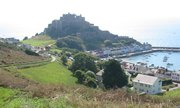Mont Orgueil dominates the small harbour of Gorey and guards Jersey from attack from the French coast opposite